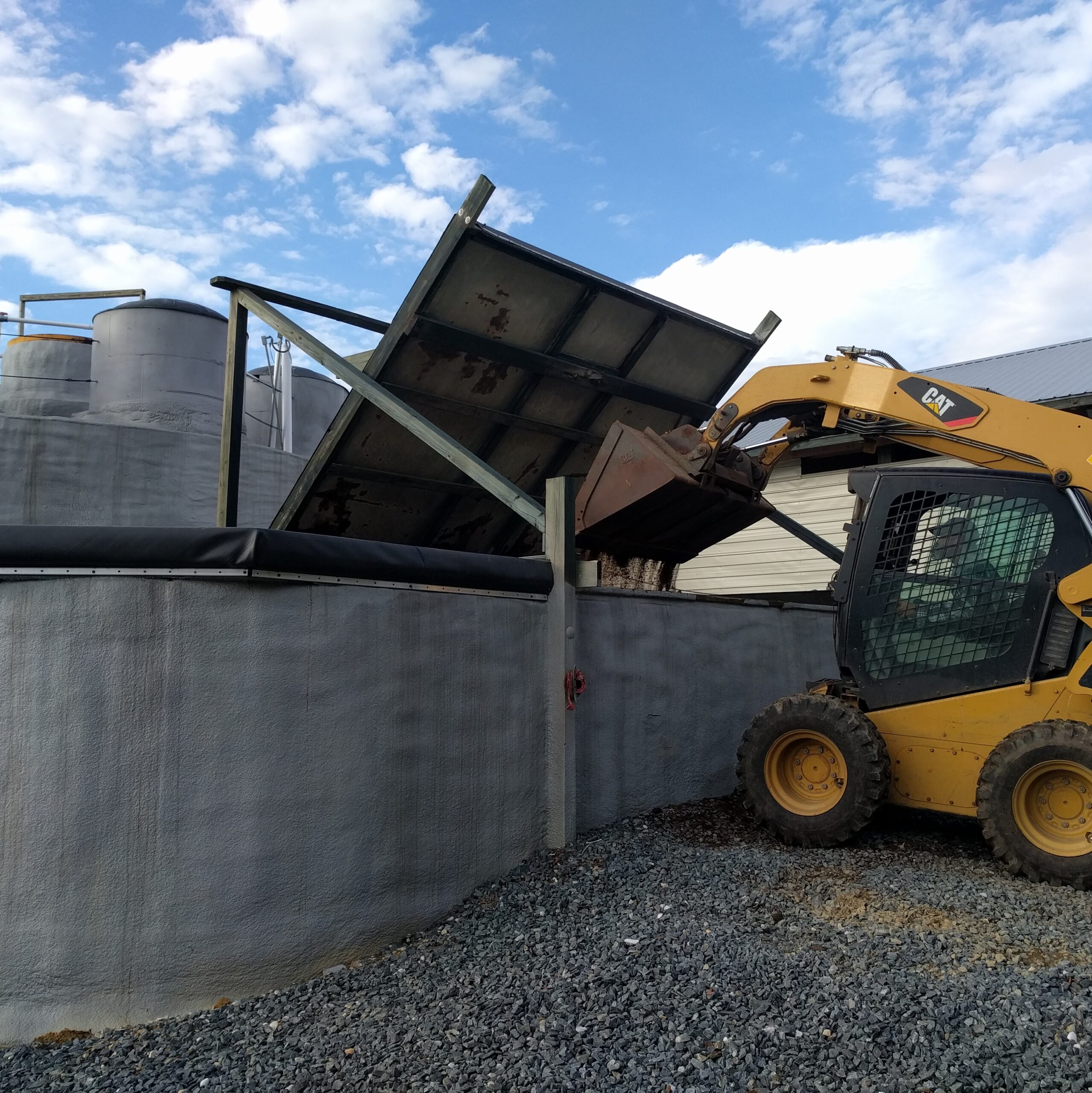Poultry litter being fed into Planet Found's anaerobic digestion and nutrient recovery facility in Pocomoke City, MD