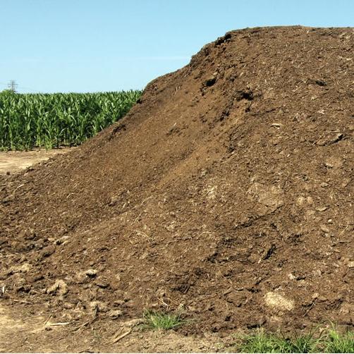 pile of poultry litter in a farmer's field